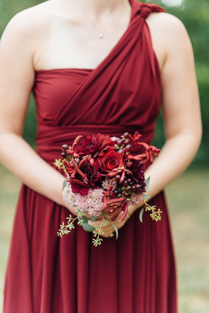 Michael Bruce in Pennsauken, New Jersey, took care of the couple's botanical needs. For the bridesmaid bouquets, he created petite arrangements of roses, dahlias, orchids and berries in vibrant shades of burgundy and merlot to complement their autumn-inspired dresses.