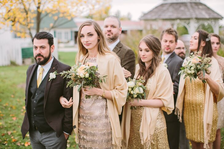 Stephanie let her bridesmaids take the lead on their wedding day attire, asking only that the girls wear dresses in gold. The girls rented their choice of sparkly sequin gowns from Rent the Runway, which they paired with gold pashmina shawls for an elegant and glam look.