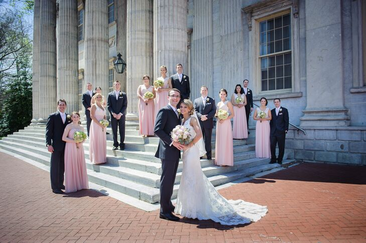 Every member of their wedding party chose a classic look with romantic flair. The bridesmaids donned pink Bari Jay dresses with floor-length pleated chiffon skirts and empire waists. Their lace overlay or strapless bodice let them all stand out. Each groomsmen highlighted their looks with matching pink ties and pocket squares against charcoal gray suits.