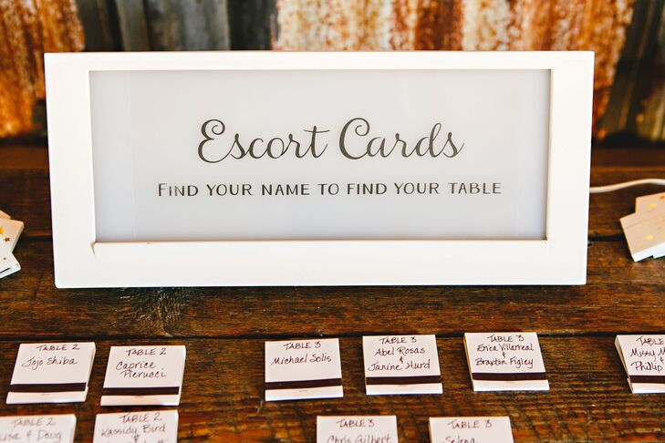 Relying on elements that served double duty, Anika and Adam's escort cards were written on matchbooks, which were favors for guests and a way for everyone to light their sparklers at the end of the night, Anika says.