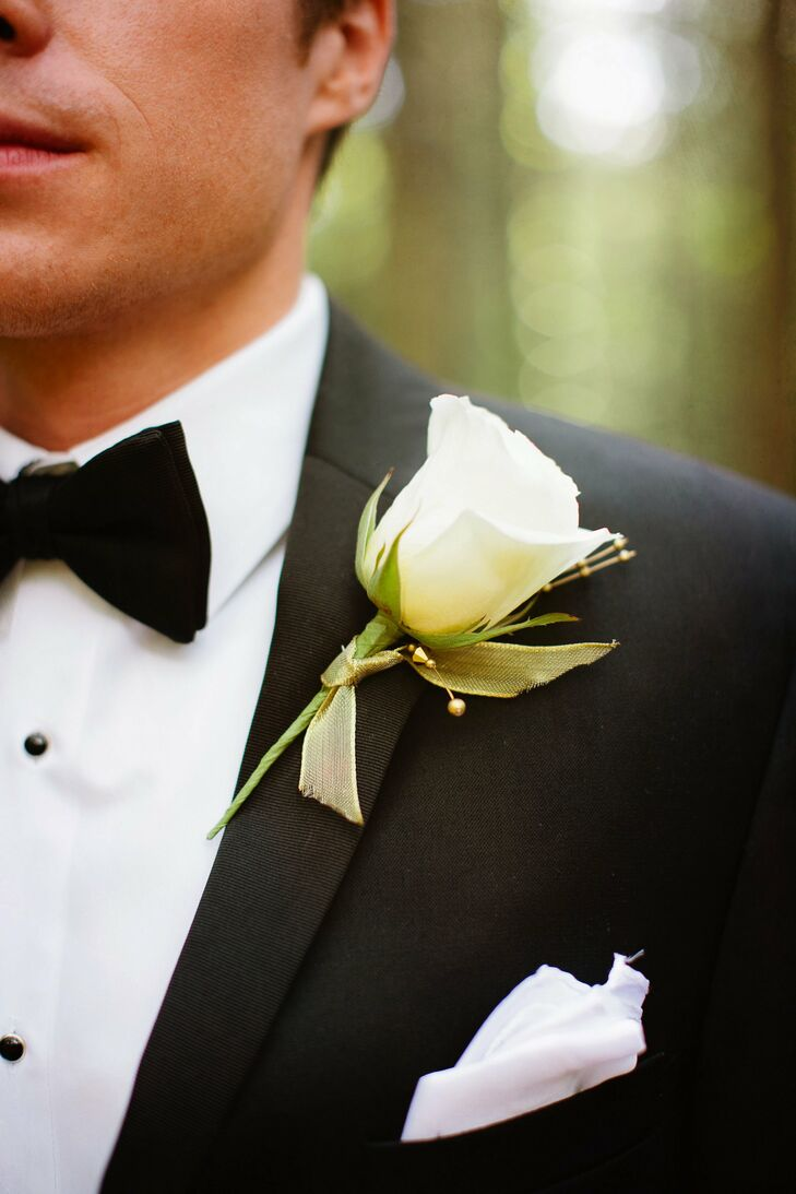 The groomsmen boutonnieres had classic white roses with gold ribbon.