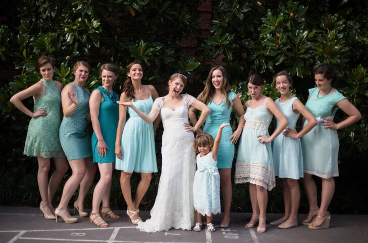The bridesmaids wore mismatched dresses ranging from Tiffany blue to turquoise.