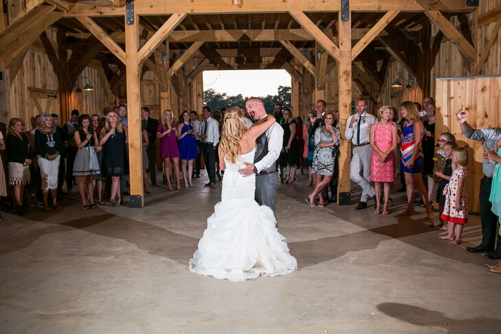 Lauren and Drake took their first dance as husband and wife inside the barn at Amador Cellars in Plymouth, California, where friends and family gathered around to enjoy the moment between the newlyweds.