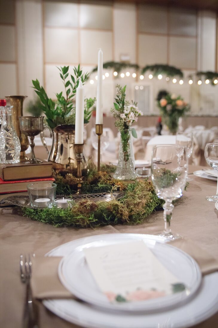 Each of the 35 tables had different centerpiece arrangements. 15 of the tables had one of a kind centerpieces with books, candles and moss.