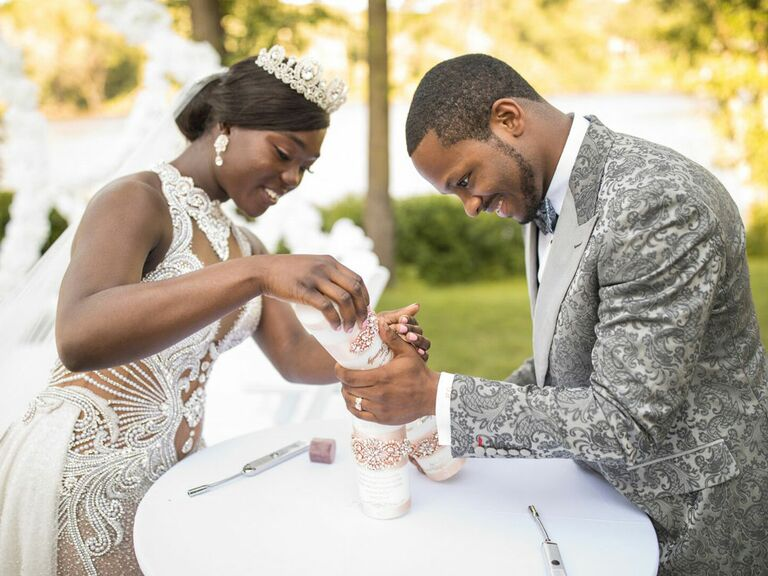 Bride and groom pouring sand during wedding unity ceremony