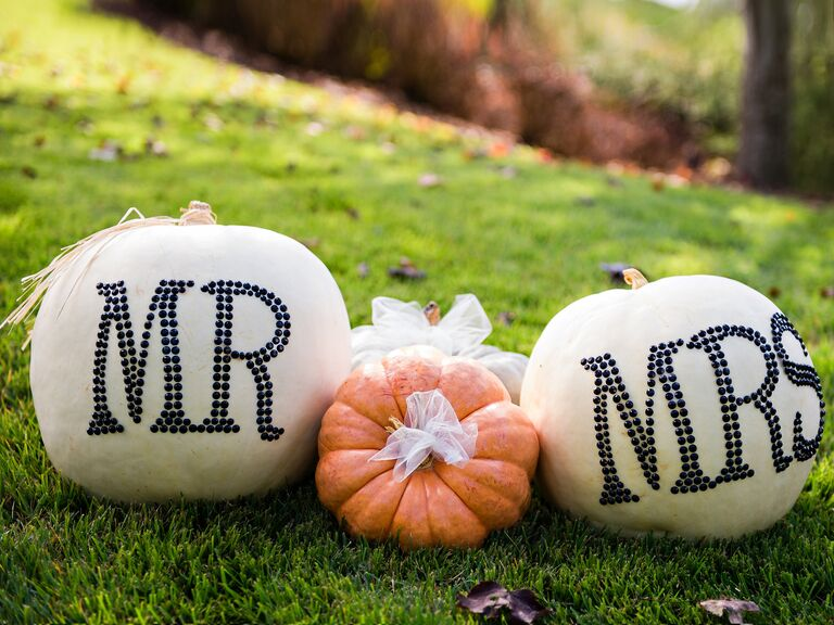 Mr and Mrs decorated pumpkins for fall wedding ceremony