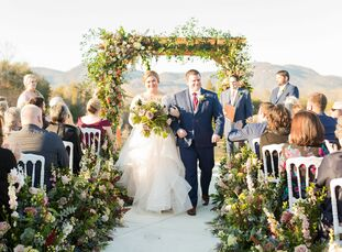 """Courtney Mills always wanted a garden-inspired wedding, and that idea took center stage when she wed Dan Roberts. """"Ever since I was a little girl, I"""