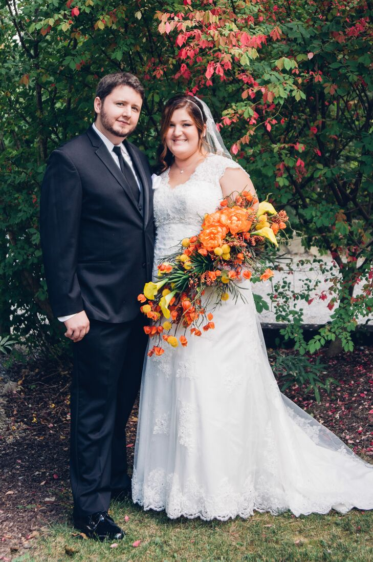 Laura carried calla lilies, succulents, billy balls and peonies in her fall-inspired bouquet.
