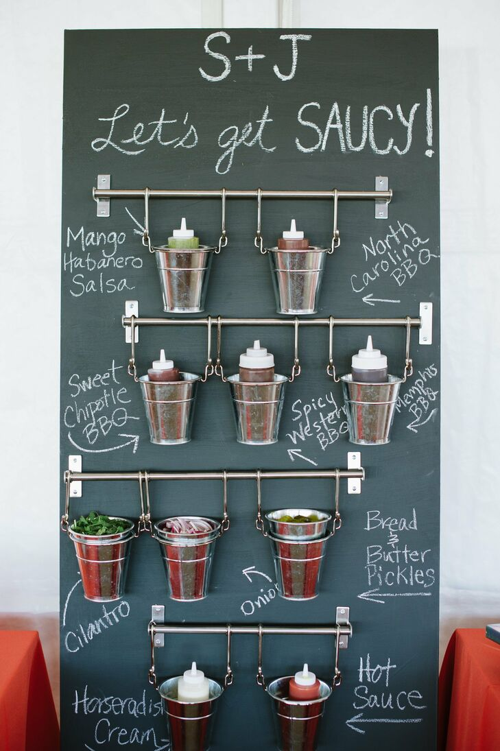 """""""One of Jake's must-haves was barbecue. Our caterer came up with the best and most elegant barbecue menu possible,"""" Stephanie says. A custom chalkboard display held a wide (and necessary!) array of sauces and fixings for guests to help themselves to."""