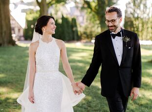"Melody	Abikhair and Paul Burgo celebrated their wedding in a tent outside of Oak Hill Country Club in Rochester, New York. ""Our wedding represented a"