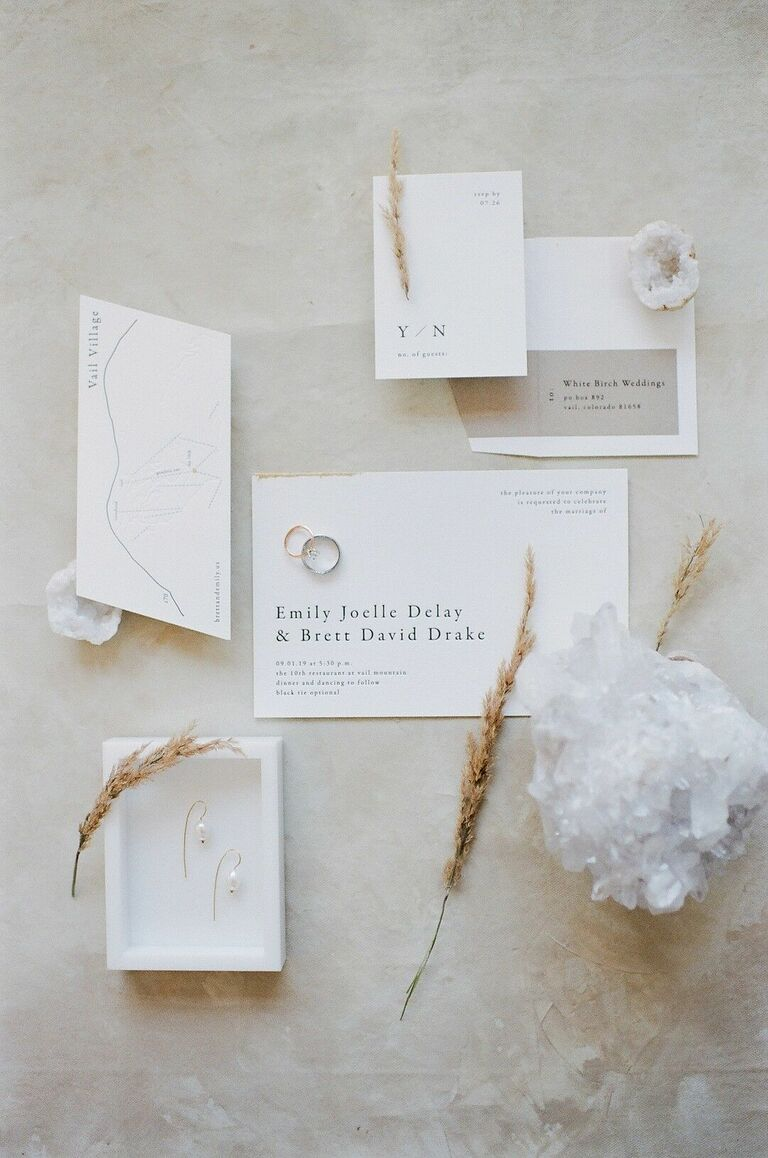 Modern and minimalist white wedding invitation suite