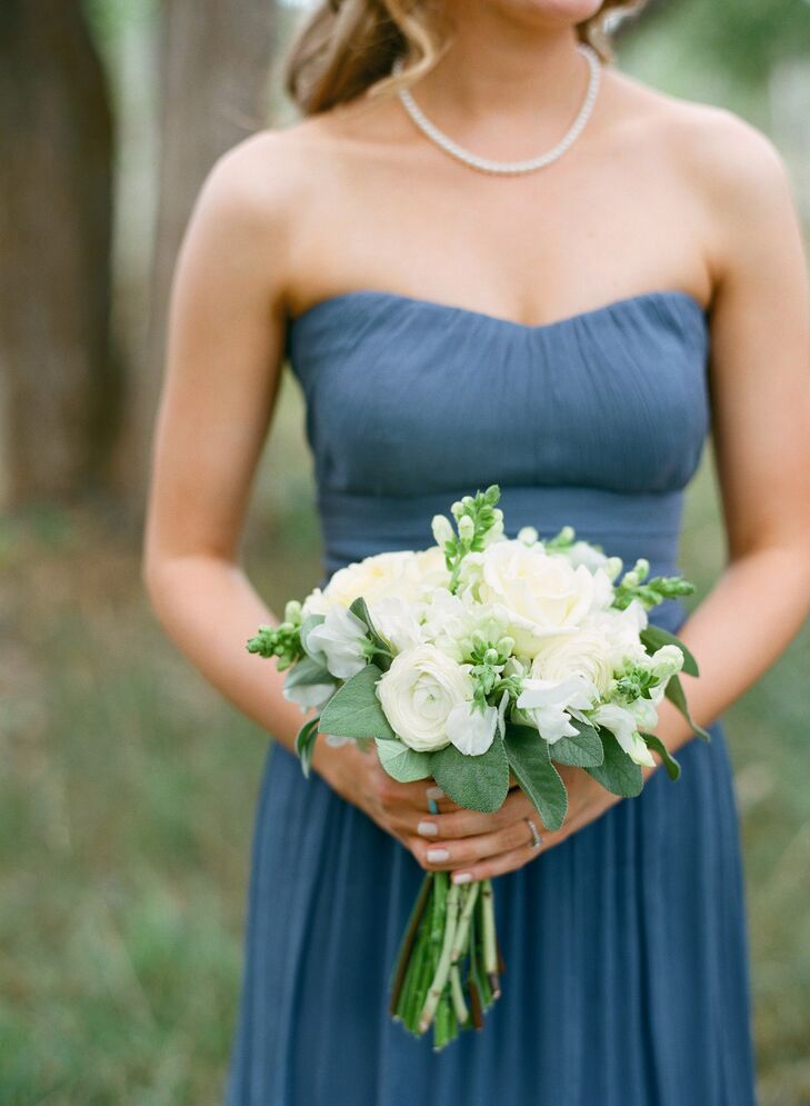 The three bridesmaids carried bouquets of ranunculus, snapdragons and roses that closely matched the bride's flowers.