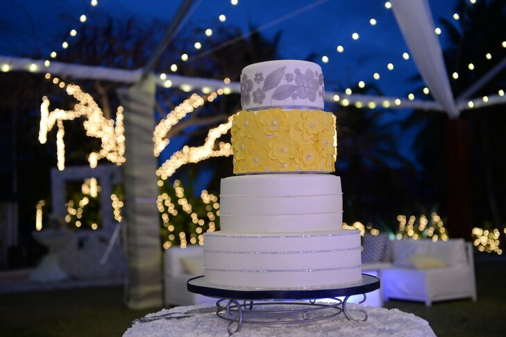 The wedding cake was a white, yellow and silver four-tiered confection that was served after the four-course reception meal.