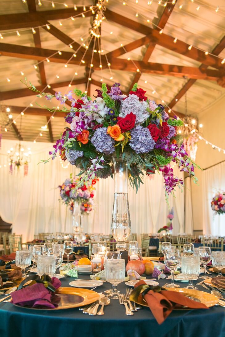 "In keeping with the enchanted garden theme, the indoor reception was bedecked with flower chandeliers made with hydrangeas, wisteria and greenery. ""My favorite detail was the hanging wisteria that my florist draped all over the ceiling of the venue,"" Kristy says."