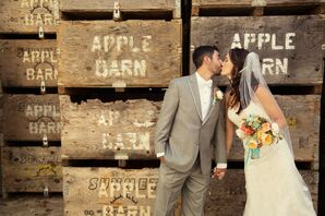 A Kiss in Front of Vintage Apple Crates