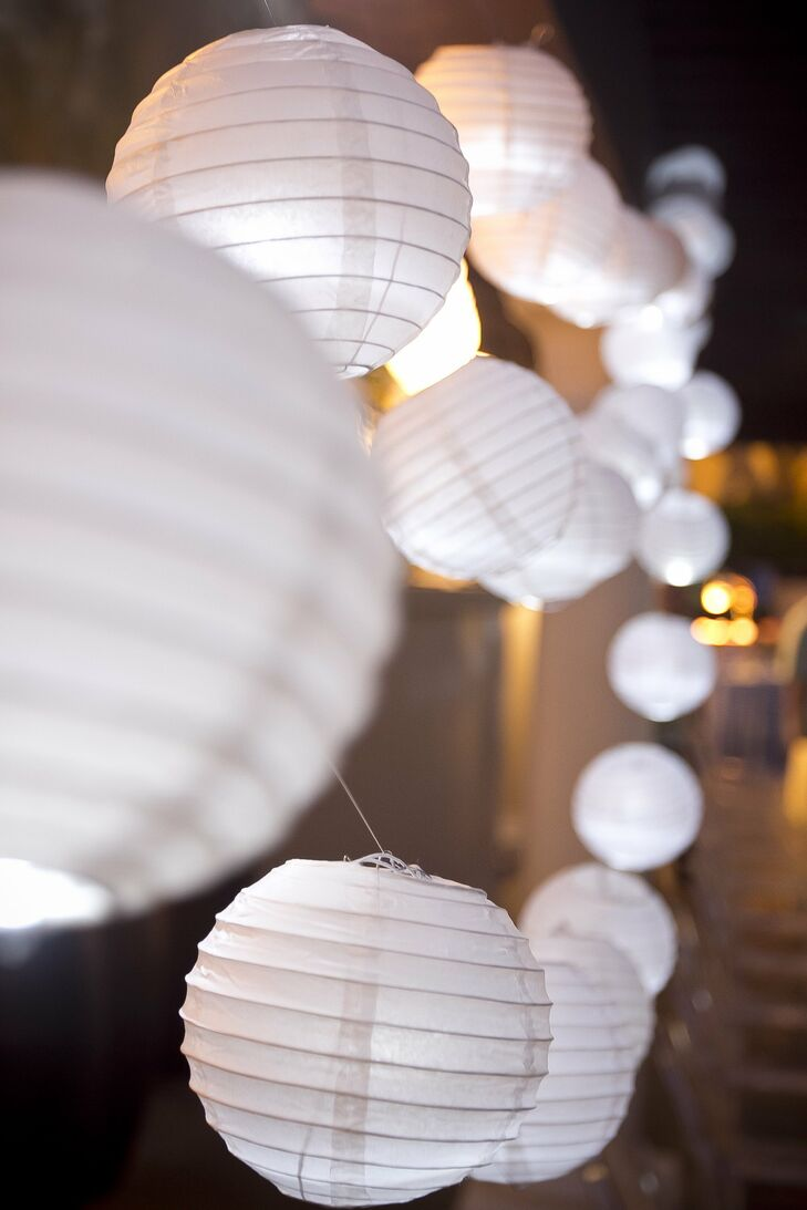 Strings of white paper lanterns added a festive, modern touch to the reception.