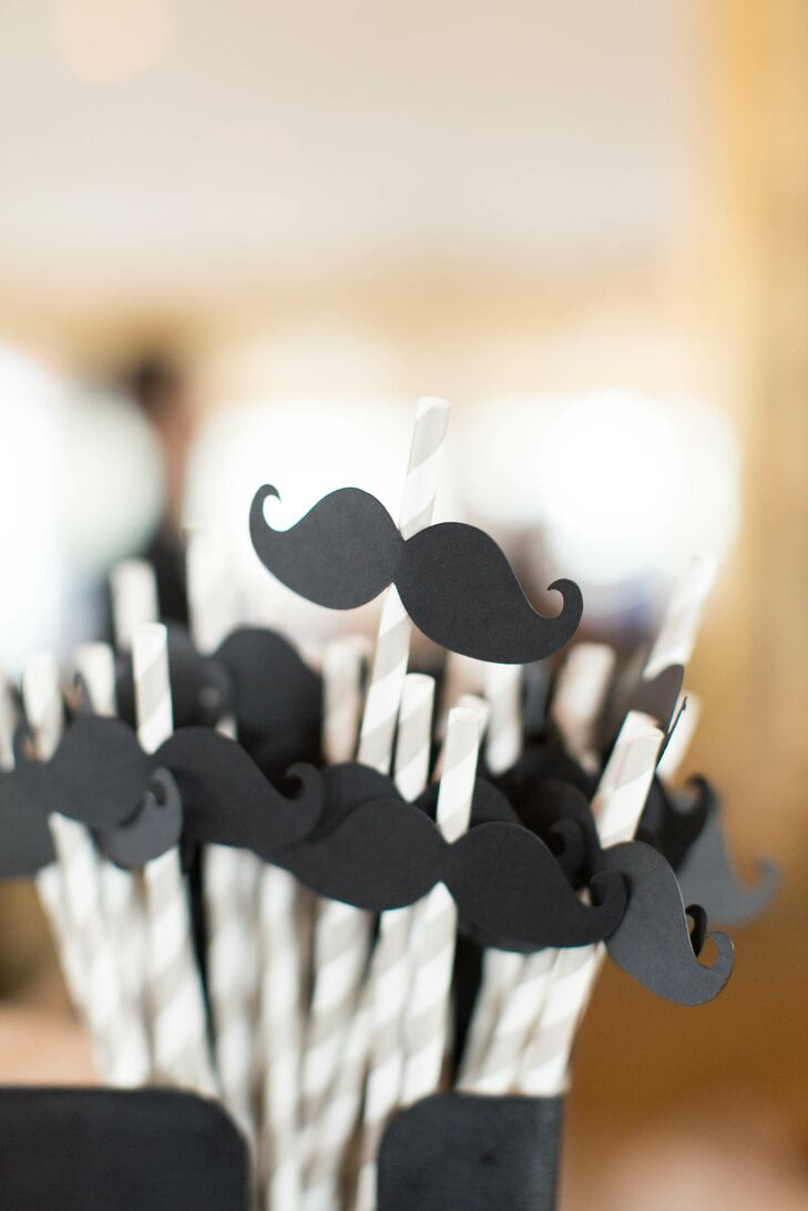 Guests were given striped gray straws with moustaches in honor of Adam's favorite show, Duck Dynasty.