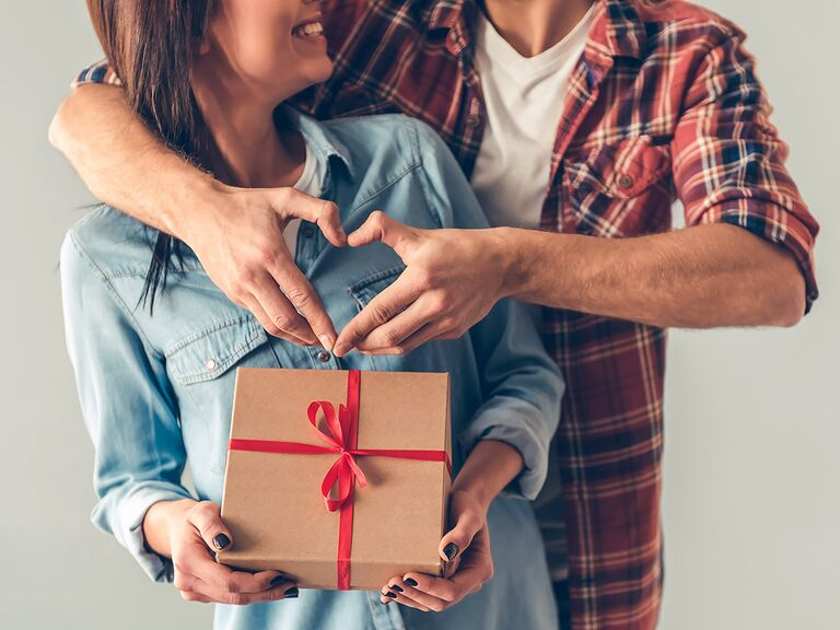 Husband giving wife 5-year anniversary gift