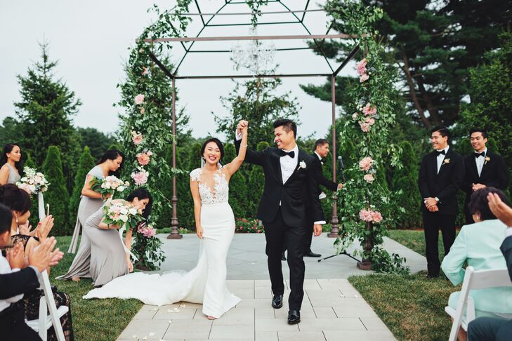 """Yan knocked her bridal look out of the park, wearing a Pronovias crepe mermaid-style Vicenta gown with an illusion lace bodice and open back for her """"I dos."""" """"The dress I ended up wearing wasn't the first dress I bought,"""" Yan says. """"I think I made the mistake of buying my first dress too early. It left too much time for having second thoughts."""" She paired the statement-making dress with Stuart Weitzman Nudist Sandal and simple drop earrings. """"I wanted a simple, single strap heel that wouldn't take away from the dress. They were also 4.5 inches, which gave me the extra boost I needed for someone as petite as I am,"""" she added."""