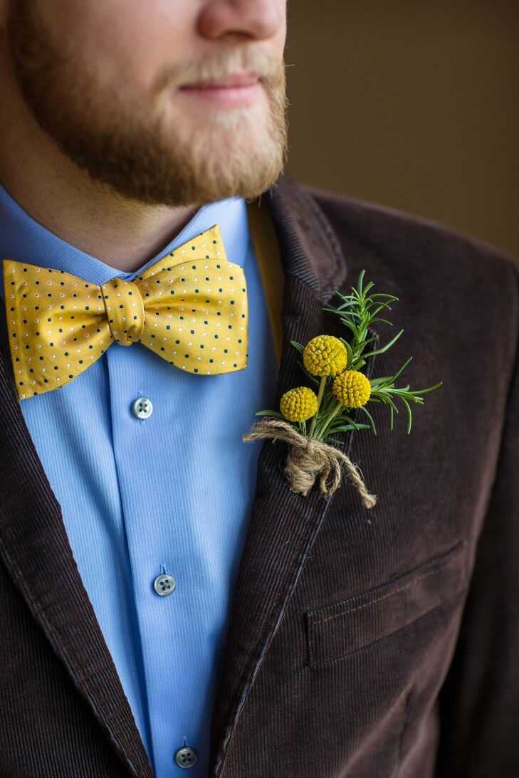 Chris wore a yellow and black polka-dot bow tie around the top of his blue collared dress shirt. He wore a brown jacket that made him stand out from his groomsmen, pinned with a yellow craspedia boutonniere on the lapel.