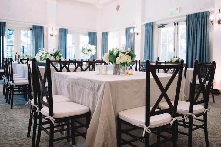 "The indoor reception was decorated with crisp white linens and simple white flower centerpieces. ""I wanted everything very neutral and natural,"" Molly says. ""My flowers were all different shades of white with greenery, and all my linens and furniture rentals were cream tones."""