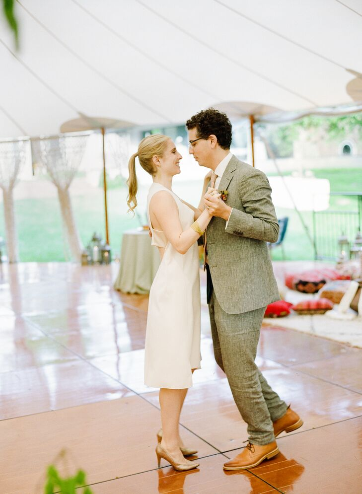 """Sarah and Paul had their first dance to a Turkish song called """"Ayrilik Olsa Bile"""" by Esmeray. The lyrics were translated and printed for their guests."""
