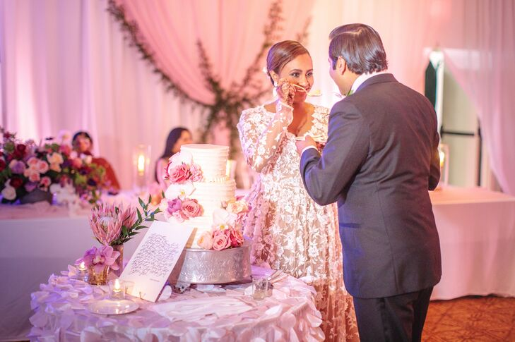 Elegant Cake Cutting with Three-Tier White Cake