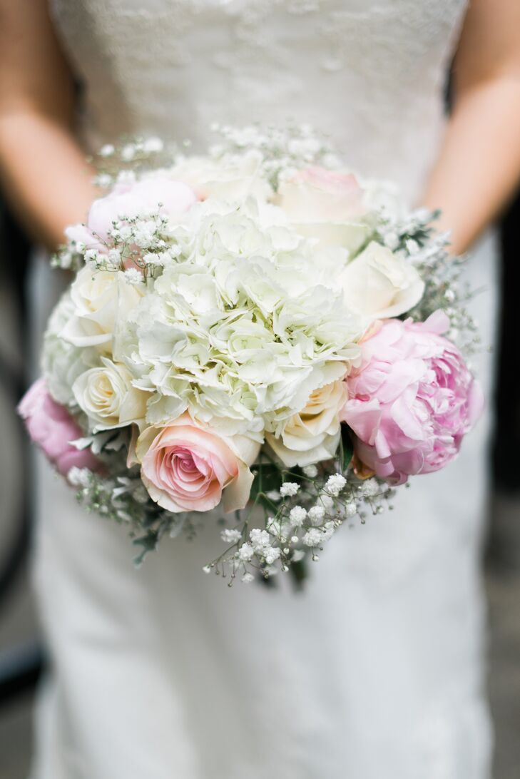 Ginnie carried a white and blush bouquet of hydrangeas, spray roses, peonies and baby's breath that channeled everything classic about her wedding.