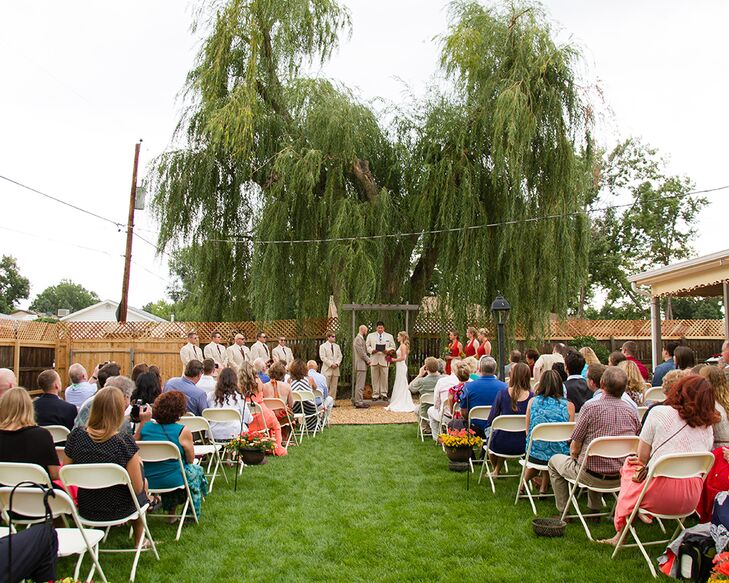 """""""We have this beautiful willow tree that we had as our backdrop and a couple of friends along with Eric surprised me with a handmade,rncustom and beautifully framing arch,"""" Sharon says. """"The setting turned out so beautiful, cozy and intimate and mainly because our family and friends were involved from the very beginning."""""""