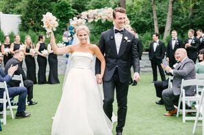 Classic Garden Recessional with Bride in Strapless A-line Wedding Dress and Groom Wearing Black Tuxedo
