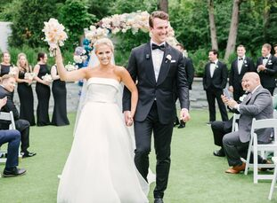 To kick off their wedding day, Bozena Podkopac and Trevor Siemian had a formal outdoor garden ceremony. They stood beneath a colorful circular wedding