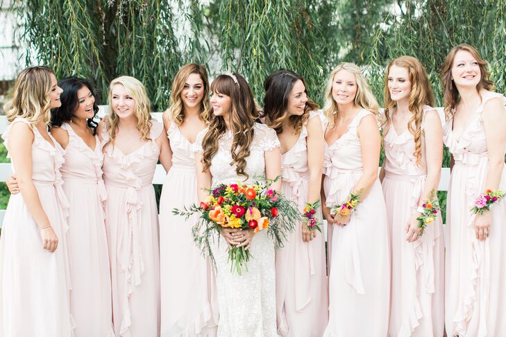 Courtney found a universally flattering bridesmaid gown that suited all eight of her bridesmaids—even one who was pregnant! They all wore the Polly Dress in blush by Joanna August from BHLDN.