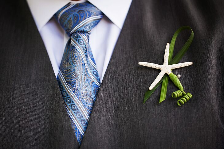 The groomsmen wore tiny dried starfish as boutonnieres.