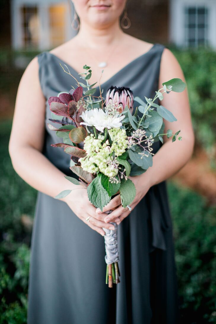 """After purchasing flowers from a local market, Charlee-Ann brought them to her bridesmaids for some quality arts-and-crafts time at the beach. """"The girls got to pick the flowers they wanted and make their own bouquet,"""" she says. """"We had so much fun—I couldn't imagine doing it any other way."""""""