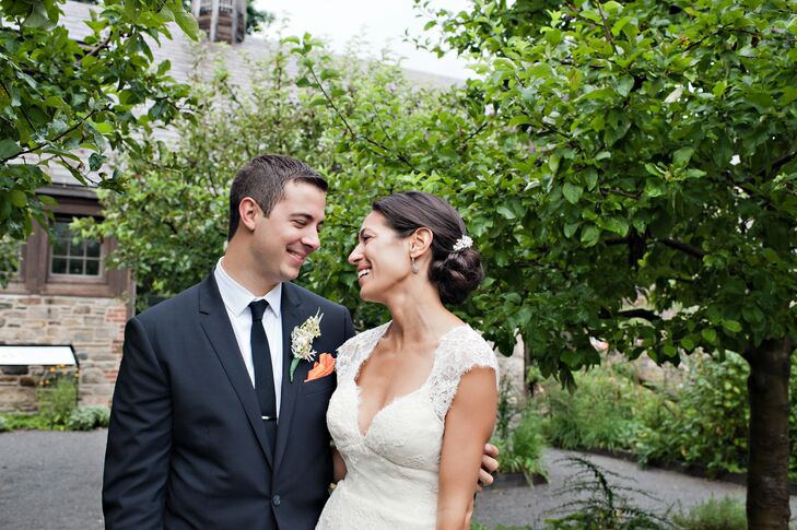 """The first dress Christine tried on ended up being """"the one."""" She wore a romantic lace gown, while TJ chose a navy suit and tie."""