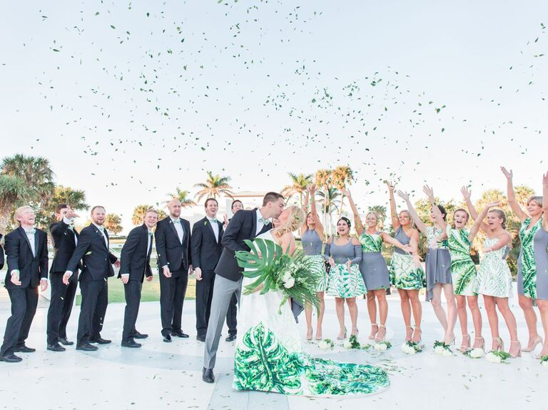 bride, groom and wedding party tossing confetti at tropical wedding