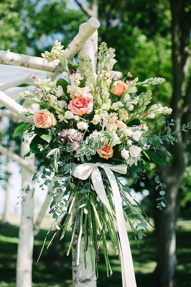 Fresh Flowers Adorning Wedding Arch