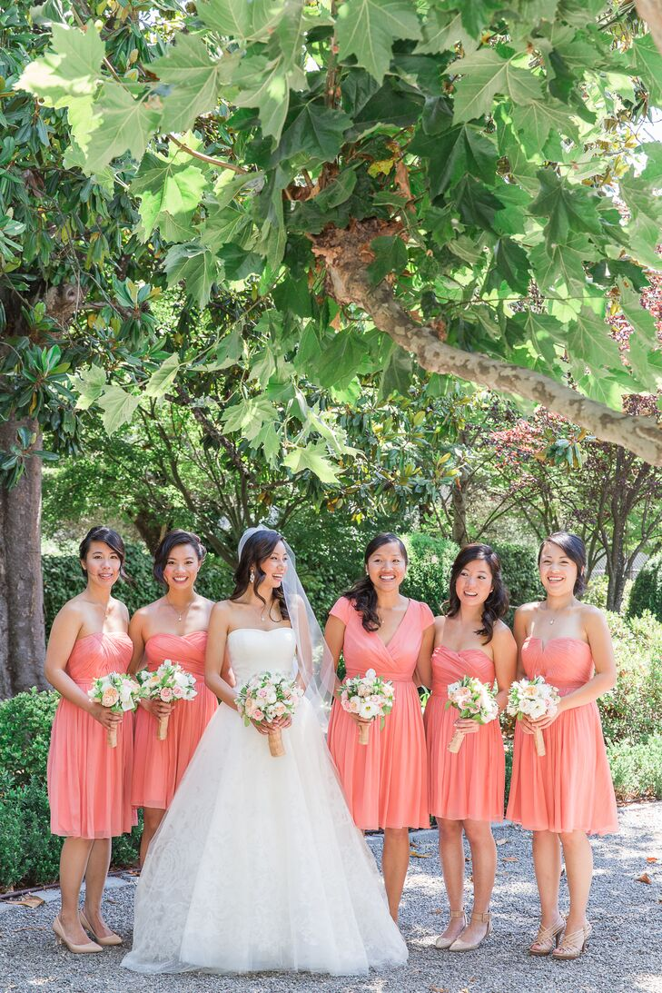 The pink and cream garden rose bouquets complemented Kristina's ivory gown and the coral bridesmaid dresses.