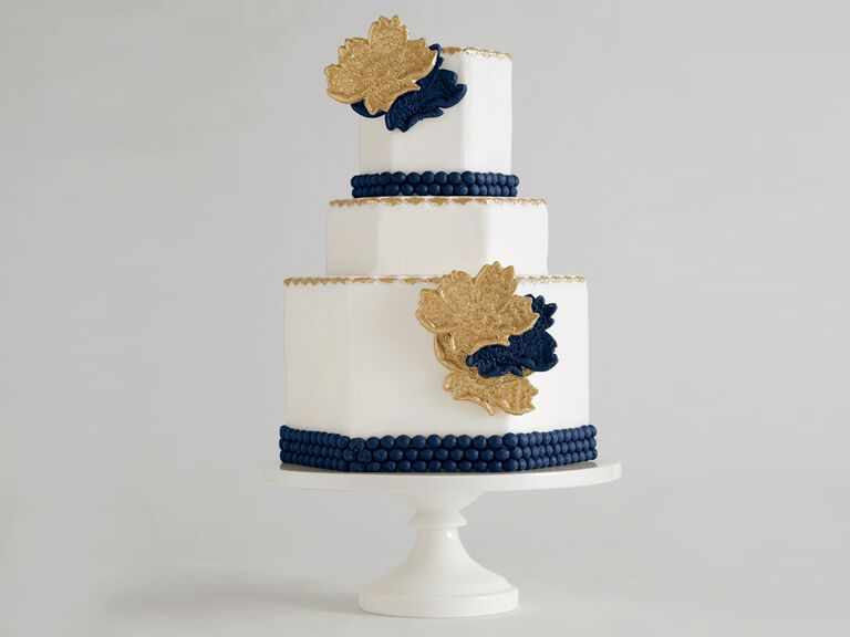 Hexagonal shaped wedding cake with navy trim