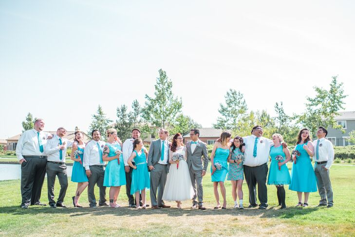 The bridesmaids chose their own dresses in turquoise, and the groomsmen wore gray pants, white button-down shirts and turquoise bow ties.