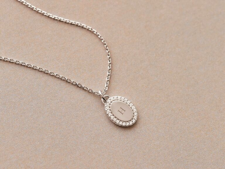 Silver oval pendant necklace with white crystals and monogram engraving