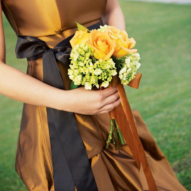 Amber's best friend, who was her only attendant, carried a bouquet of pale orange roses and green and white hydrangeas.