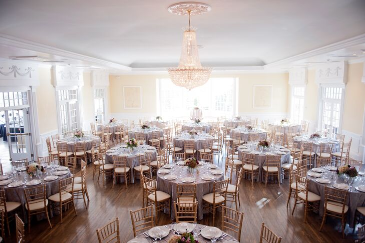 The ballroom at West Estate Manor features large, sunny windows and beautiful crystal chandeliers.