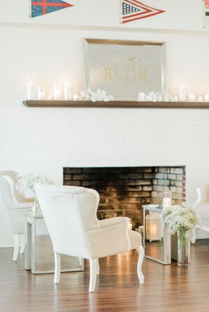 Neutral and Metallic Lounge Area with Candles and Monogrammed Mirror