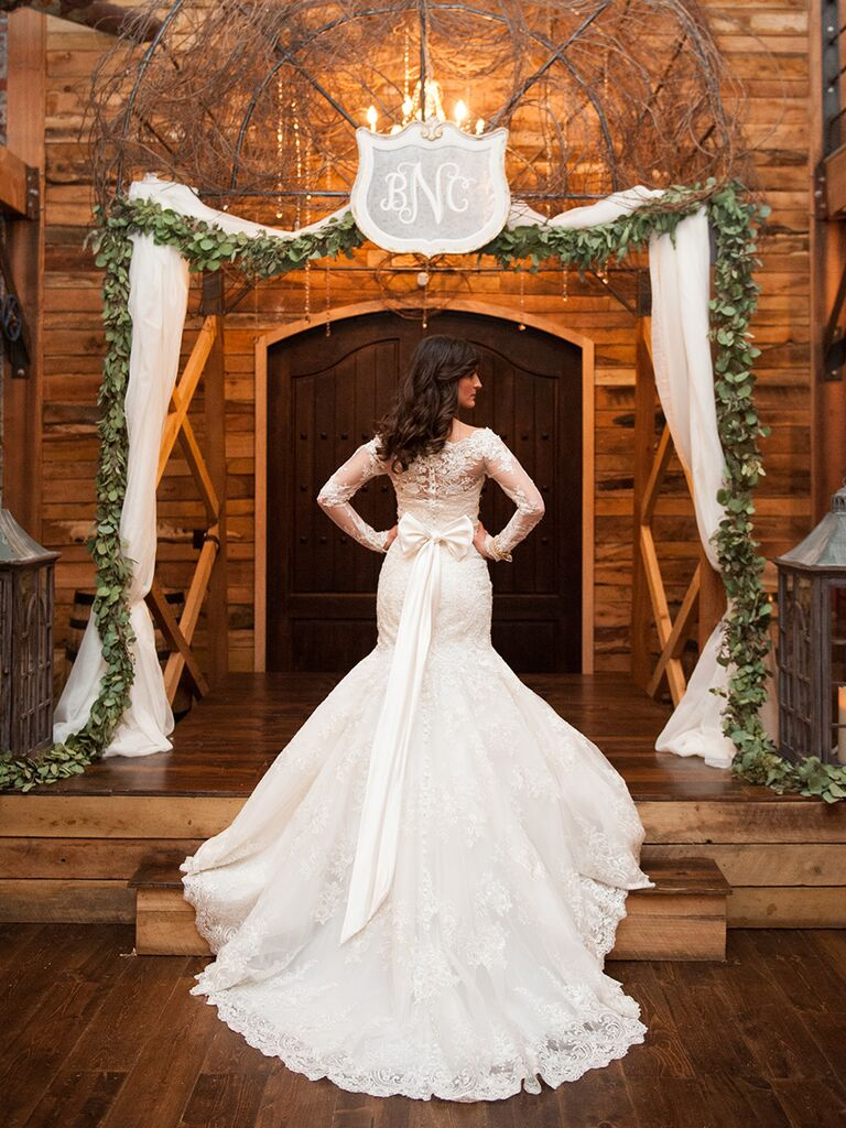 Winter wedding dress with buttons, lace and a bow