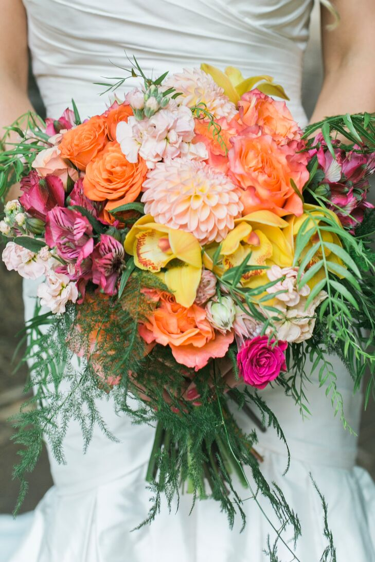 """I love bright colors. I'm known for loving corals, pinks, oranges and yellows,"" Jillian says. ""My bouquet was bright and bold. It had pinks, corals, oranges, peach tones and pops of yellow with dahlias—one of my favorite flowers—garden roses, spray roses and greenery to give it a whimsical feel."" Bridesmaids carried similar arrangements."