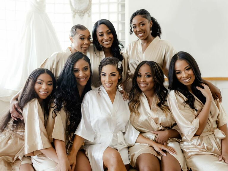 Photo of bridesmaids and bride in matching robes