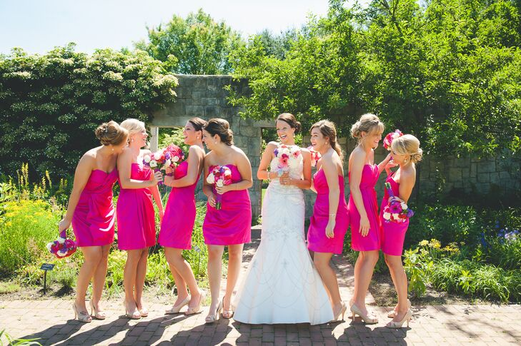 Jaycie wore an ivory wedding dress with a sweetheart cut and beaded accents, which was purchased from David's Bridal. The bridesmaids stood next to her, wearing bright pink knee-length dresses.