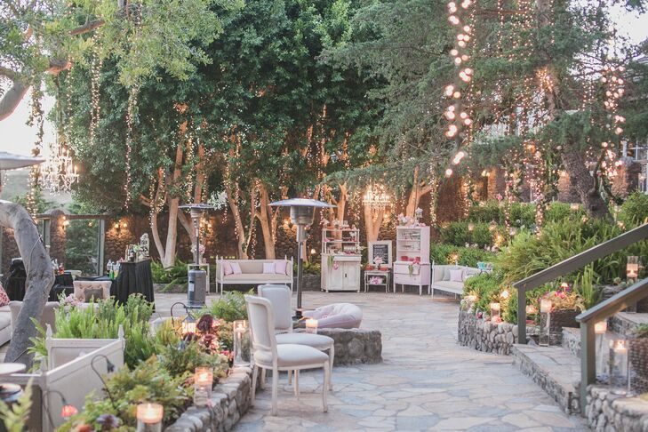 Comfortable furniture was scattered throughout the outdoor space, where twinkle lights hung from the trees and created a romantic ambience.