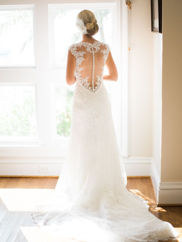 """""""I went with a dress that was more simple in style but still had the fine details: ivory with beautiful lace. It was fitted, but I could still move around and enjoy myself in it,"""" Nicole says."""